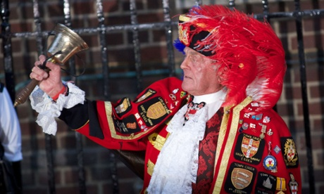 A Town Crier announces about the the birth of the royal baby outside St Mary's hospital in London.