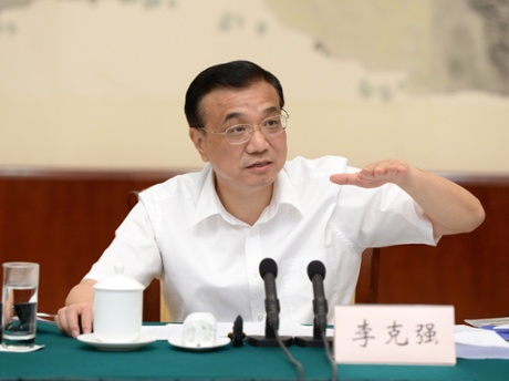 Chinese Premier Li Keqiang addresses a symposium on the economic situation of a number of provinces and regions in Nanning, capital of southwest China's Guangxi Zhuang Autonomous Region, July 9, 2013