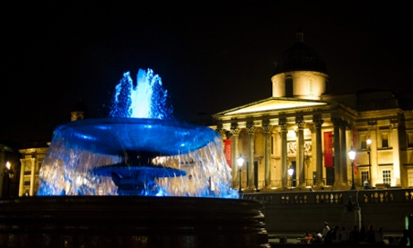 The fountains in Trafalgar Square are illuminated in blue to mark the birth of a royal baby boy.