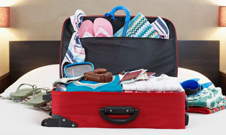 Packed suitcase on Bed