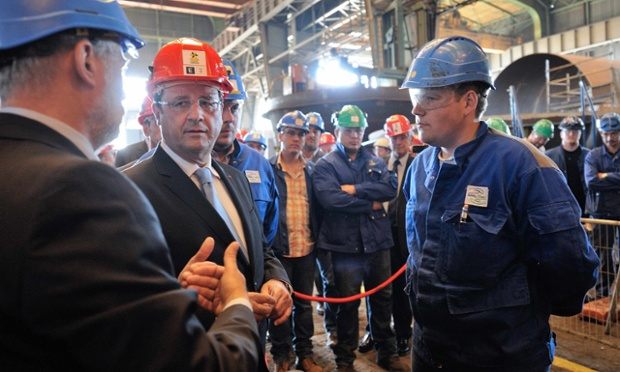 French President Francois Hollande (2ndL), wearing a helmet, speaks with employees of the CMP boiler factory in Dunkirk, northern France, July 23, 2013 as part of a visit focused on employment, professional training and social dialogue.