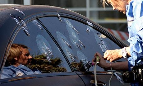 A ballistics investigator at work on Radovan Krejcir's bullet-proof car