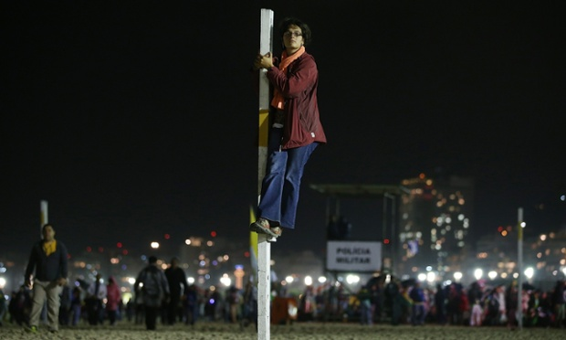 Noemie Magniny from France takes a pole position as Pope Francis celebrates Mass on Copacabana Beach.