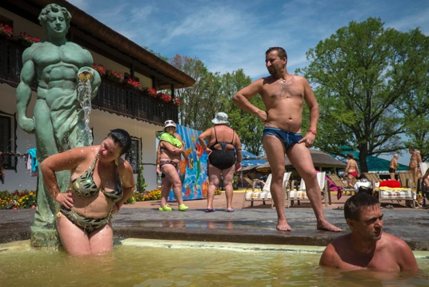 People rest in the waters of thermal hot springs at the Kosino recreational complex, Ukraine.