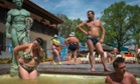People rest in the waters of thermal hot springs at the Kosino recreational complex, Ukraine