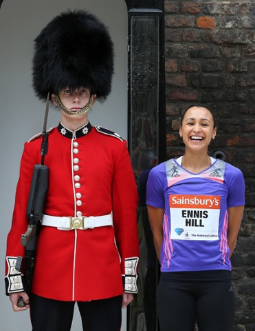 Guarded expression - Jessica Ennis-Hill poses with an unamused sentry at the Tower of London, ahead of the Sainsbury's Anniversary Games.