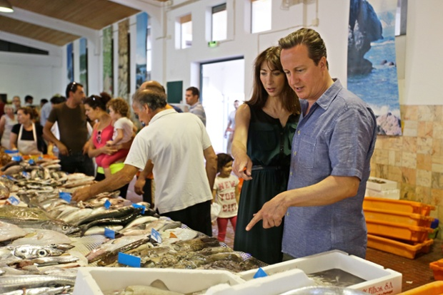 British Prime Minister David Cameron and his wife Samantha visit a fish market while on holiday in Aljezur, on the southwestern coast of Portugal.