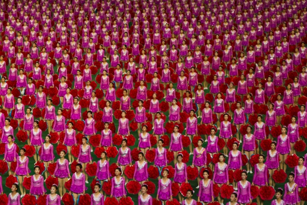 North Korean girls stand to attention at the end of a performance of the