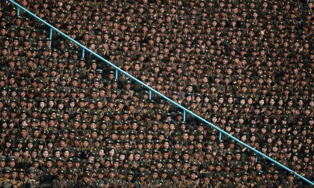 Soldiers clap as they listen to President of the Presidium of the Supreme People's Assembly of North Korea Kim Yong-nam (unseen) deliver a speech ahead of the mass gymnastic and artistic performance in Pyongyang.