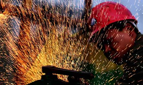 A Chinese worker does welding job at a construction site