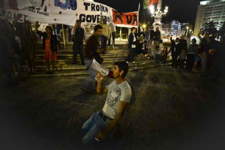 A man uses a megaphone during a protest against the government, in Lisbon on July 2, 2013, following an announcement by Portuguese Prime Minister Pedro Passos Coelho after the resignation of his Foreign Minister, Paulo Portas.