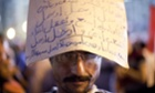 Egyptian protester with a sign on his head in Tahrir Square