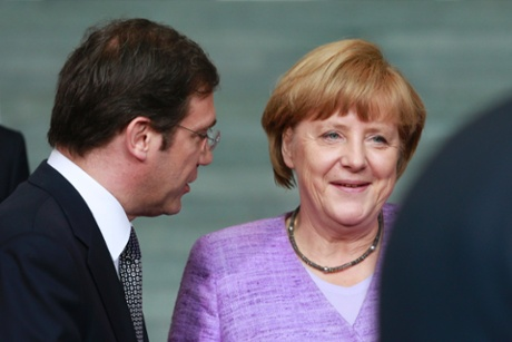 Portugal's Prime Minister Pedro Passos Coelho  talks with German Chancellor Angela Merkel at an EU conference on Youth Unemployment in Berlin, July 3, 2013.