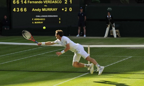 Andy Murray dives to make a return.