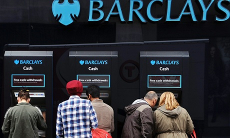 Customers use ATM machines outside a Barclays bank branch in London, Britain, 09 October 2012.