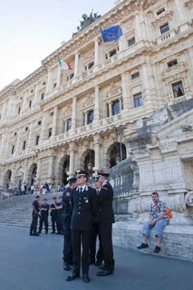 Police forces stand outside the Court of Cassation building where former Premier Silvio Berlusconi's case on tax fraud will be decided, in Rome, Tuesday, July 30, 2013.