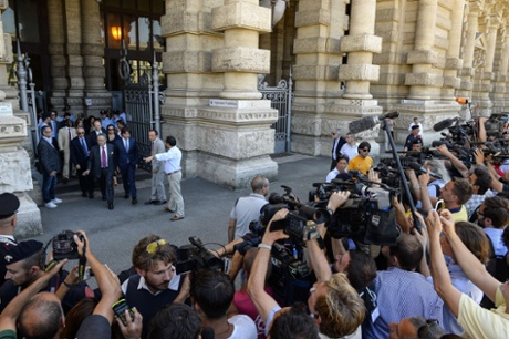 The lawyer of former Italian prime Minister Silvio Berlusconi, Franco Coppi (3rd L) walks out of the entrance of the Court of Cassation building, during a pause of the supreme court session which will decide whether to confirm former Italian Prime Minister Silvio Berlusconi's one-year prison sentence and five-year ban from politics in a long-running tax fraud case involving his media business interests, on July 30, 2013, in central Rome.  The final appeal hearing began on July 30 but one of Berlusconi's lawyers told reporters that the verdict may come only on July 31 or August 1.