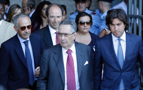 Silvio Berlusconi's lawyer Franco Coppi, center, leaves the Court of Cassation building where Berlusconi's case on tax fraud will be decided, in Rome, Tuesday, July 30, 2013.