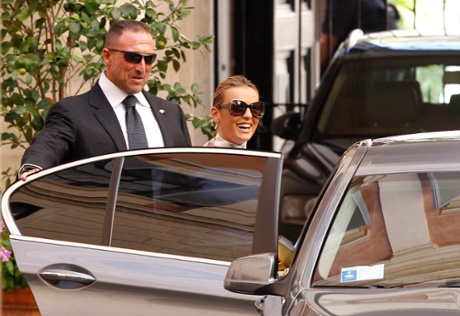 Francesca Pascale, the girlfriend of Italian former Premier Silvio Berlusconi, leaves his residence in Rome, Tuesday, July 30, 2013. Berlusconi is waiting in his home in Rome for the decision that will change his political fate as Italy's highest court hears arguments in the former premier's fraud conviction.