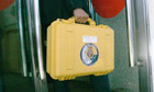 Spanish police bring the black boxes from the derailed train to court