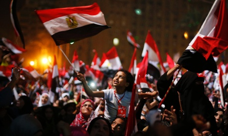 Egyptians celebrate in Tahrir square last night after the army ousted President Mohamed Morsi. The head of Egypt's armed forces General Abdel Fattah al-Sisi issued a declaration on Wednesday suspending the constitution and appointing the head of the constitutional court as interim head of state, effectively declared the removal of elected Islamist President.