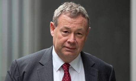 Banker Ian Hannam leaves the High Court in London