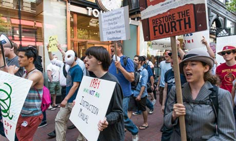 Protesters on Market Street in San Francisco. Photograph: Justin Benttinen
