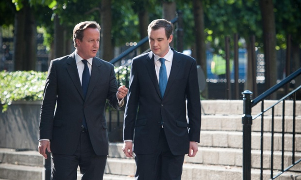 David Cameron talking to James Wharton (R), the Conservative backbencher introducing the bill proposing a referendum on Britain's membership of the European Union.