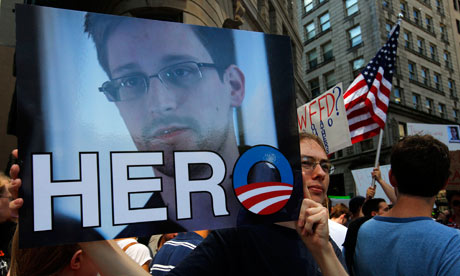 A demonstrator holds a photograph of Edward Snowden