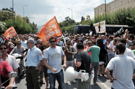 Municipal workers march in front of the Greek Parliament in Athens on July 5, 2013 after Greek officials have apparently proposed that 4.000 municipal police officers be transferred to the Greek Police force.