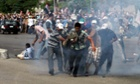 Supporters of the ousted Egyptian President Mohamed Morsi carry protester who was shot during the clashes next the headquarters of the Republican Guard in Cairo, Egypt. Follow events