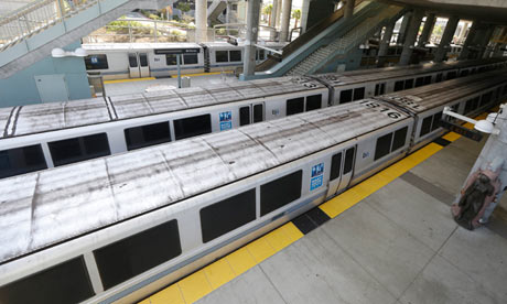 Bay Area Rapid Transit trains parked at a station in Millbrae