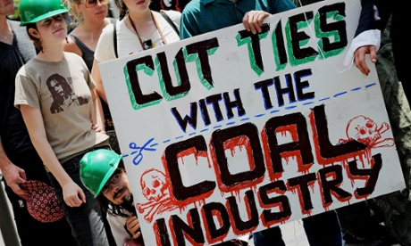 Enviroment activists display an anti-coal industry placard outside the New South Wales Parliament building in Sydney.
