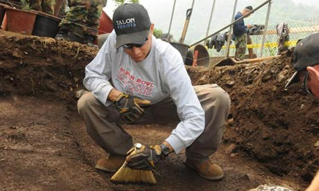 Marine Sgt Alexander Mazza sweeps for human remains at an excavation site in South Korea in 2009. Photograph: Jesse Shipps/US Defense Department