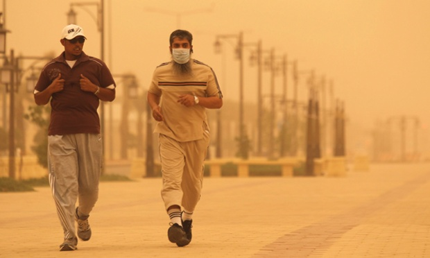 Two men jog during a dust storm in Riyadh, Saudi Arabia.