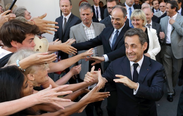 Former French President Nicolas Sarkozy and other UMP dignitaries leave the UMP political party headquarters in Paris. Former French President Nicolas Sarkozy made his first political appearance since losing power, staging an appeal to hundreds of conservative lawmakers to help save the UMP party from financial ruin. Photograph: Philippe Wojazer/Reuters