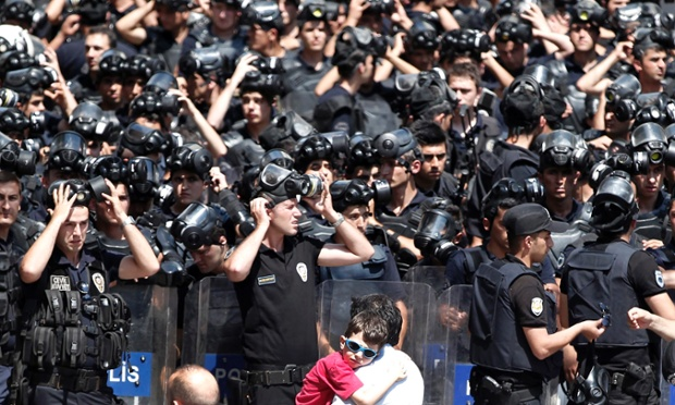 Moments before: Turkish riot police prepare to disperse protestors during an anti-government protest near Taksim Square in Istanbul.
