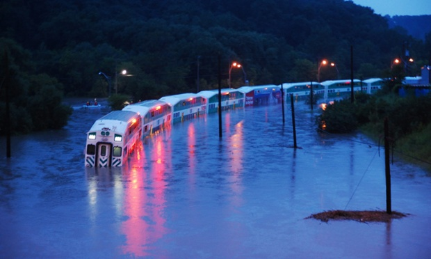 A train is stranded on flooded tracks in Toronto. A severe thunderstorm forced the shutdown of Toronto's subways, and cut power to 300,000 people in Canada's largest city.