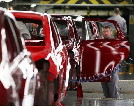 A technician assembles a Nissan car on the production line at Nissan's Sunderland plant on January 24, 2013 in Sunderland, England. The Japanese manufacturer's factory employs 6,225 people producing the Juke, Note and Qashqai models.
