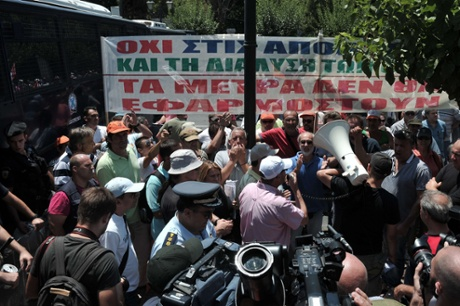 Municipal employees chants slogans in front of the ministry of administrative reform in Athens, during their protest rally  on July 9, 2013.