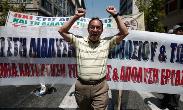 A municipal worker shouts slogans against the government during a rally against public sector reforms in Athens July 9, 2013.