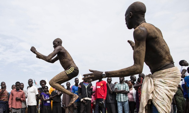 Dinka men, a traditional dance at celebrations for South Sudan's second anniversary of independence in Juba