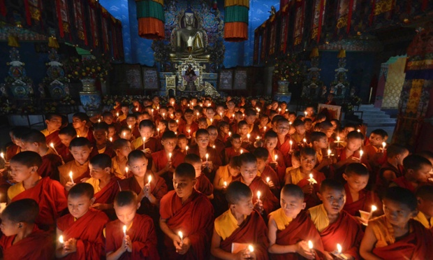 Novice Buddhist monks offer prayers for peace at the Tergar Monastery, the site of an explosion, in Bodh Gaya, India.