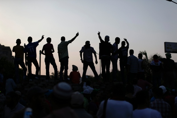 Supporters of ousted President Mohammed Morsi protest at the Republican Guard building in Nasr City, Cairo, Egypt.Photograph: Hassan Ammar/AP
