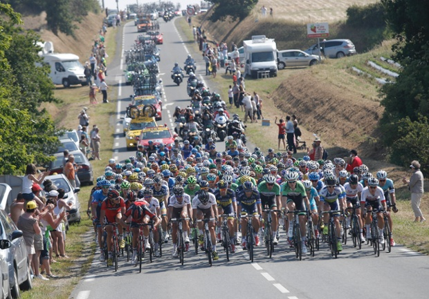 The pack rides during the tenth stage of the Tour de France cycling race over 197 kilometers (123.1 miles) with start in in Saint-Gildas-des-Bois and finish in Saint-Malo, Brittany region, western France.