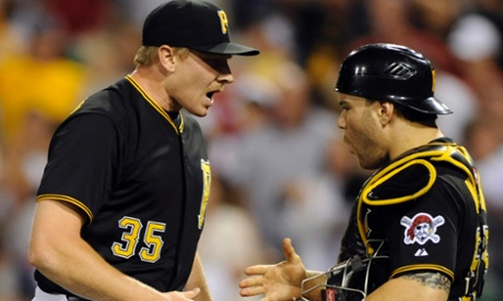 Pittsburgh Pirates closer Mark Melancon celebrates with teammate Russell Martin they beat the St Louis Cardinals yet again on Wednesday.