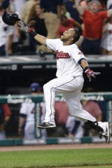 Cleveland Indians' Carlos Santana celebrates after rounding third base on his solo home run off Chicago White Sox relief pitcher Dylan Axelrod.