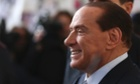 Silvio Berlusconi smiles as he arrives at Milan's central train station, Italy.
