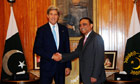 John Kerry shakes hands with the president of Pakistan, Asif Ali Zardari, in Islamabad