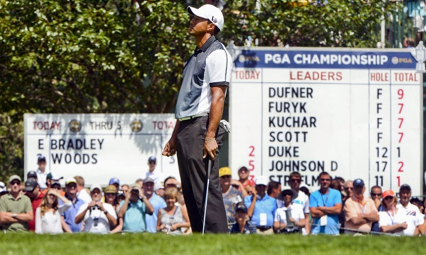 Tiger Woods looks dejected after missing his birdie butt at Oak Hill's fifth green.